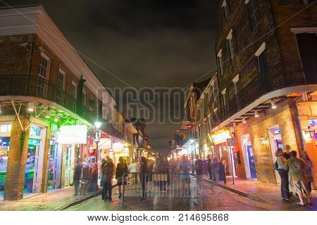 NEW ORLEANS - JUN. 1, 2017: Historic Buildings on Bourbon Street at Conti Street in French Quarter at night in New Orleans, Louisiana, USA.