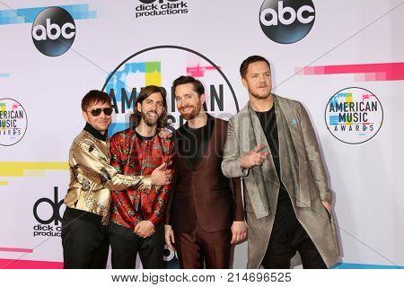 LOS ANGELES - NOV 19:  Ben McKee, Daniel Wayne Sermon, Daniel Platzman, Dan Reynolds, Imagine Dragons at the American Music Awards 2017 at Microsoft Theater on November 19, 2017 in Los Angeles, CA