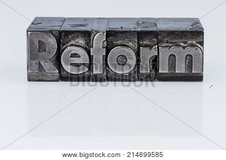 reform written in lead letters