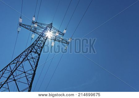electricity pylon with sun and sky