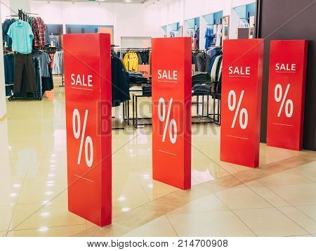 seasonal discounts in the store. text sale in a shop entrance. black friday in store, discount shop.