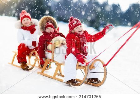 Kids On Sleigh. Children Sled. Winter Snow Fun.