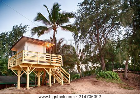 coastguard hut on sandy beach on Hawaii with palm trees