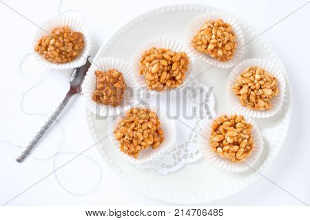 Puffed rice balls. Sweet dessert with toffee and puffed rice