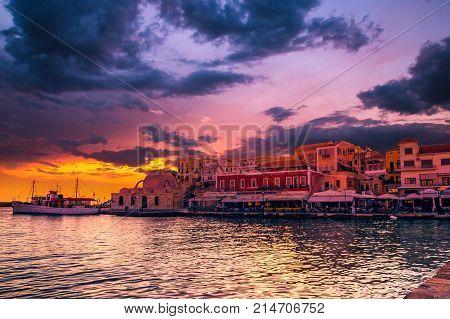 CHANIA, CRETE ISLAND, GREECE - JUNE 26, 2016: View of the old venetian port of Chania on Crete island Greece.