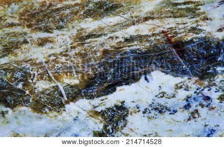 Serpentine subgroup mineral stone macro view. Greenish brownish color polymorphs asbestos gem background.