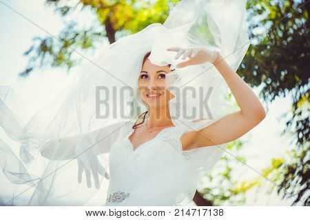 Tender Happy Bride In A Veil, A Happy Woman In A Wedding Dress, A White Veil Covers Her Face, Gentle