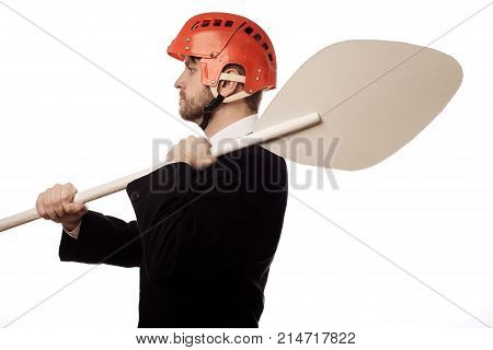 Balanced Businessman In A Helmet And With An Oar In His Hands