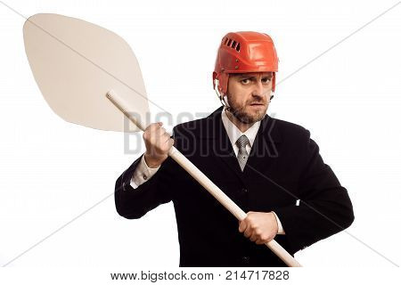 Austere Businessman In A Helmet And With An Oar In His Hands