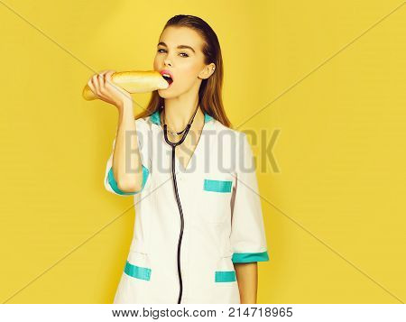 Pretty Nurse Woman Or Doctor Eating Baton