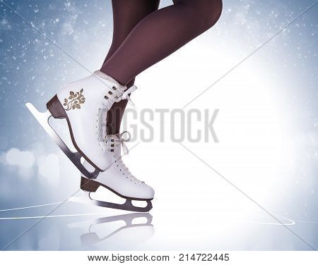 Woman legs in ice skating boots .