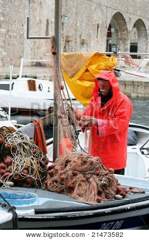 Fisherman with fishing net (Dubrovnik, Croatia).