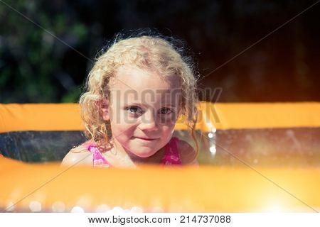 girl in paddling pool