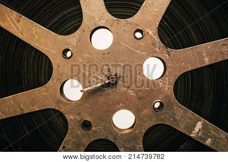 Close up of old vintage film reel, ancient movie equipment, abstract retro movie background