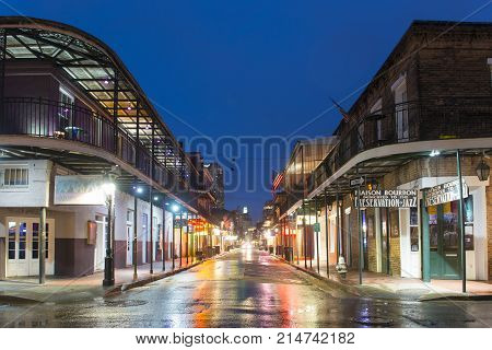 NEW ORLEANS - JUN. 1, 2017: Historic Buildings on Bourbon Street at St Peter Street in French Quarter at night in New Orleans, Louisiana, USA.