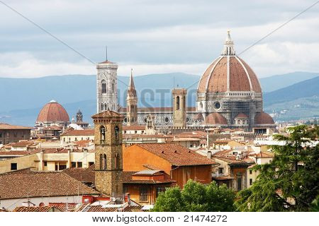 Florence seen from Michelangelo square: Palazzo Vecchio, the Duomo and Campanile Tower, beautiful sky, hills in the horizont.