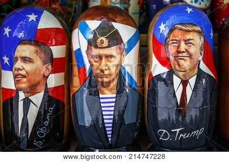 Saint Petersburg, Russia - Circa June 2017: Nesting dolls - Russian national wooden dolls with the image of Vladimir Putin, Donald Trump and Barack Obama, Russian souvenirs