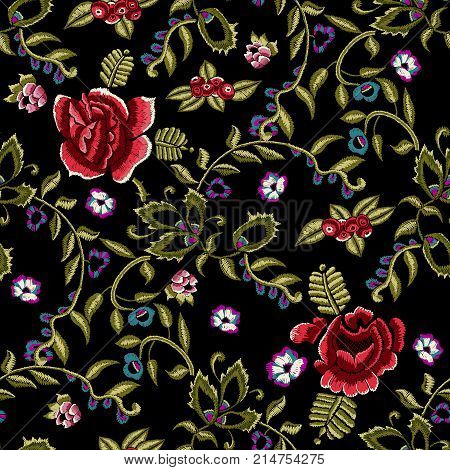 Embroidery ethnic seamless pattern with simplify red roses and rowanberry. Vector trend floral bouquet. Tribal style design for fashion wearing.