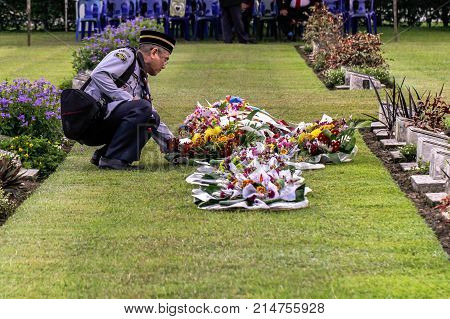 Labuan,Malaysia-Nov 12,2017:Malaysian's leader scout uniform laying a wreath of flowers during the Remembrance Day at Labuan War Memorial park in Labuan,Malaysia.