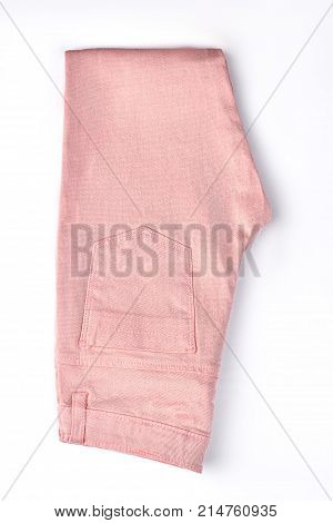 Girls new cotton trousers, top view. High quality brand trousers for young woman on sale. Childrens pockets leggings isolated on white background.