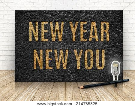 Inspiration Quote,new Year New You Word With Lightbulb And Pencil On Stone Block At Wood And Brick R