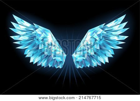 Polygonal sparkling wings of blue clear ice on a blue background. Ice wings.