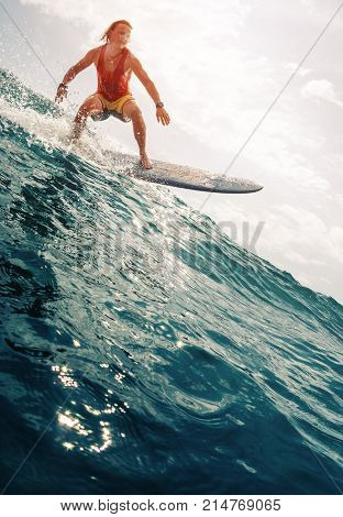 Surfer rides the ocean wave. Extreme sport and high speed action
