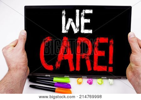 We Care Text Written On Tablet, Computer In The Office With Marker, Pen, Stationery. Business Concep