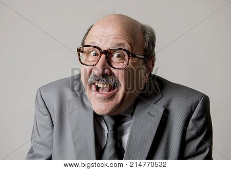 portrait of happy and cheerful senior mature 60s business man smiling wearing dressing formal necktie looking cheerful and excited isolated on grey background