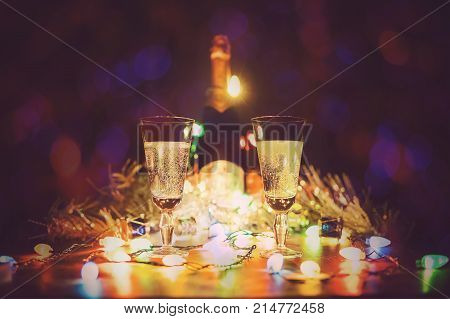 Glasses With Champagne Stand On A Wooden Table