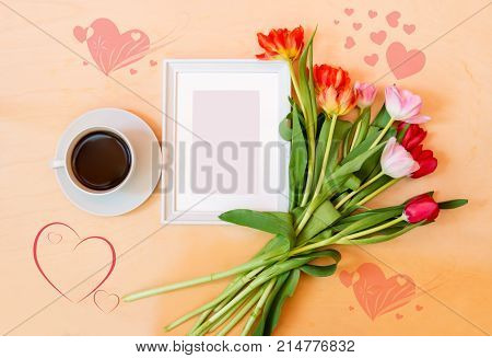 Cup of coffee picture frame and tlip flowers