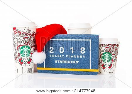 Chiang Mai Thailand- 18 November 2017 - 2 sizes Grande and Venti of Starbucks Coffee paper cups in beautiful 2018 Christmas design set up on display with holiday special design notebook on white background in Chiang Mai Thailand on November 18 2017`
