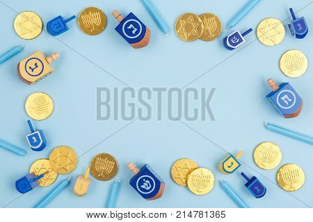 Blue Background With Multicolor Dreidels, Menora Candles And Chocolate Coins. Hanukkah And Judaic Ho