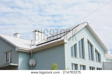 White clay tiled roof and solar panels solar water heating for house energy efficiency. White Roof Bring Cool Savings and can reduce air conditioning costs by up to 20 percent.