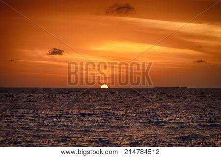 Sunset In The Maldives. Beautiful Colorful Sunset Over The Ocean At Maafushi Island,maldives