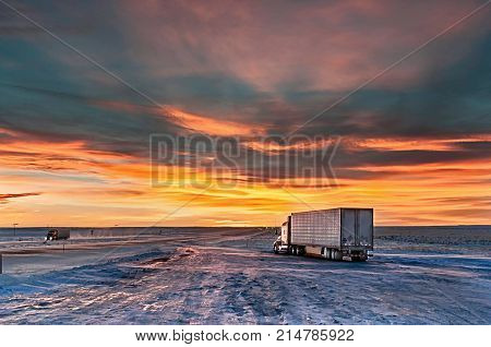 lonely traveler at sunset on the truck stop