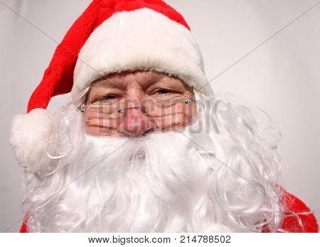 Santa Claus makes funny faces in a FISHEYE Lens. Funny Santa Claus Photos.
