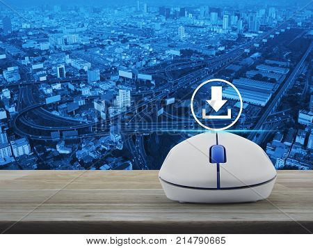 Download icon with wireless computer mouse on wooden table over city tower street and expressway Business internet concept