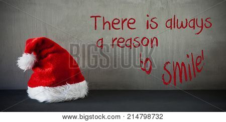 Gray Grungy Cement Wall With English Quote There Is Always A Reason To Smile. Sanat Hat For Seasons Greeting Card.