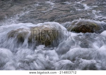 wave covers the rock in the sea