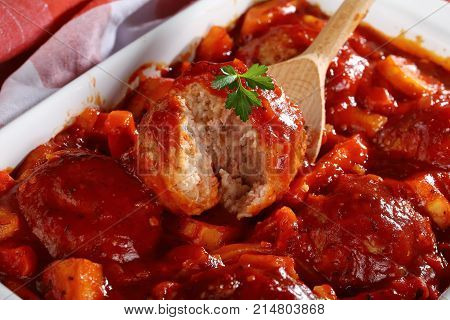 Close-up Of Wooden Spoon With A Meatball