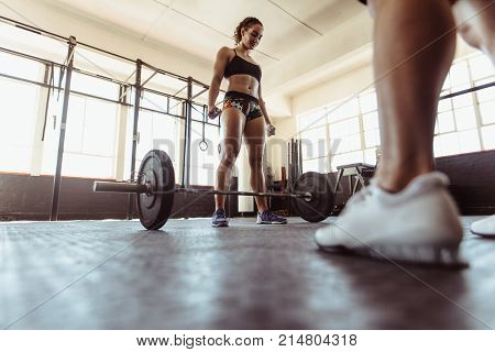 Fit Woman Working Out With Heavy Weights In Gym