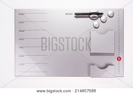 Gray blank magnetic board as a weekly planner or monthly planner