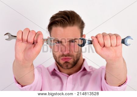Man With Serious Face Holds Wrench Tools On White Background