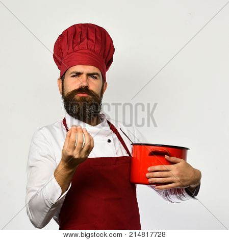Chef Holds Soup Or Compote Making Active Gesture.