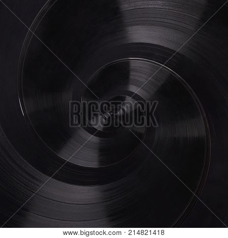 Abstract music vinyl disc spiral fractal background. Retro music vinyl disc abstract fractal. Vintage musical conceptual image swirl pattern background. Spiral effect concept. Music abstract fractal