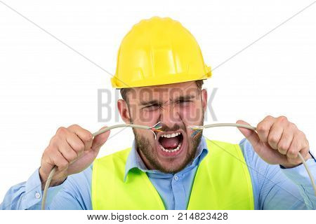 Portrait of crazy electrician over white background.