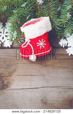 Christmas decorations on old dark boards. Christmas background. Christmas Socks. New Year background. Xmax background. Christmas tree. Toned image.