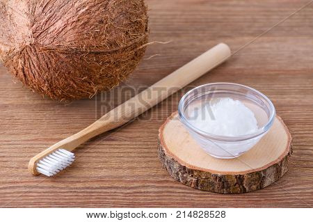 coconut oil toothpaste, natural alternative for healthy teeth, wooden toothbrush, dental equipment