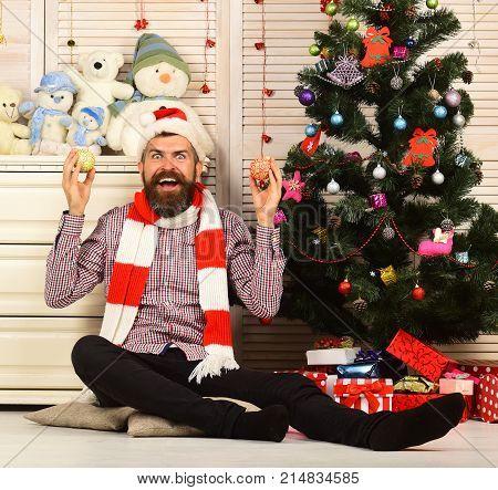 Guy Decorates Christmas Tree. Celebration And Decor Concept.